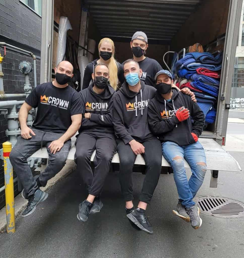 crown movers team on the back of a moving truck after a successful home move