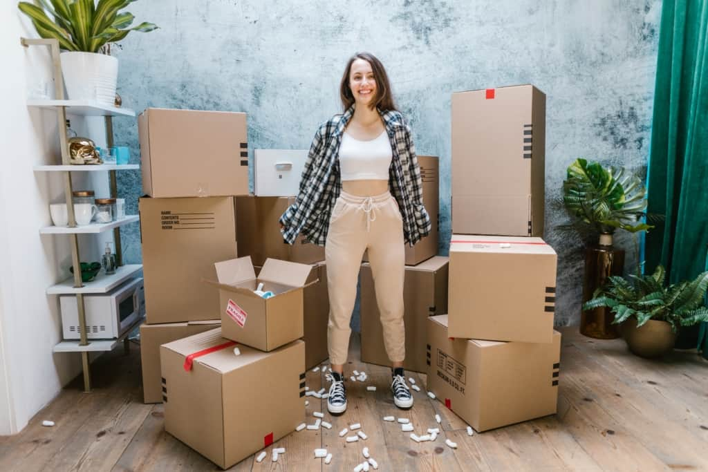 girl surrounded by moving boxes in montreal